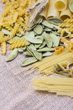 Variety of types and shapes Italian pasta Stock Images