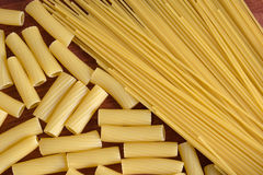 Variety of types and shapes of Italian pasta. Dry pasta backgrou royalty free stock image