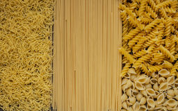 Variety of types and shapes Italian pasta. Dry pasta background Stock Photos