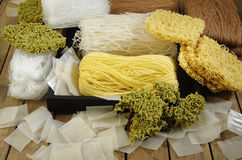 Variety types and shapes of noodles on wooden background Stock Photo