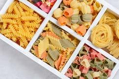 Variety of types and shapes of raw Italian pasta. Royalty Free Stock Photo