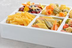 Variety of types and shapes of raw Italian pasta. Royalty Free Stock Images