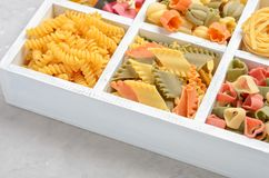 Variety of types and shapes of raw Italian pasta. Stock Image