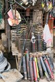 Variety of used auto and motorbike springs at a junk shop royalty free stock photos