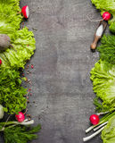 Variety of vegetables on a black wooden table. Spring still life. View from above Royalty Free Stock Image
