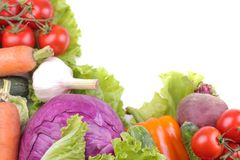 A variety of vegetables including a tomato pepper cabbage beetroot zucchini and carrots on a white isolated background royalty free stock photography