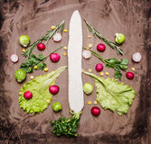 A variety of vegetables, laid out in the form of Christmas and New Year tree, radish, daikon, lettuce, Brussels sprouts on wooden Stock Image