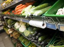 Variety of vegetables on shelves in grocery store Stock Photos