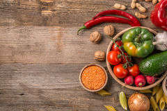 Variety of vegetables, space for text left, topview. Variety of fresh farm vegetables on dark table, additional space for text left, topview Royalty Free Stock Photography