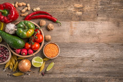 Variety of vegetables, space for text left, topview. Variety of fresh farm vegetables on dark table, additional space for text, topview Stock Photography