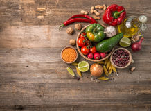 Variety of vegetables, space for text left, topview. Variety of fresh farm vegetables on dark table, additional space for text left, topview Stock Images