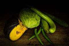 Variety of  vegetables at wooden table Stock Images