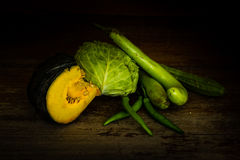 Variety of  vegetables at wooden table Royalty Free Stock Photo