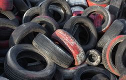 Variety of waste tyres dumped in a big pile. Dump used a variety of tires lying in a large pile stock photography