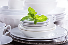 Variety of white dinnerware Stock Photos