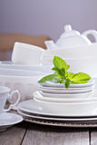Variety of white dinnerware Stock Images