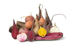 Variety of multi Colored beets. Variety of whole and half multi Colored beets on white background Royalty Free Stock Photography