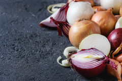 Variety of whole and sliced onion Royalty Free Stock Photo