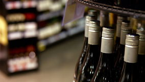 Variety of wine bottles in grocery section. At supermarket stock footage