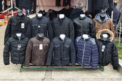 A variety of winter jacket for sale in preparation for harsh winter. A variety of winter jacket for sale at European outdoor flea market in preparation for harsh royalty free stock image