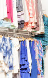 Variety of women clothes hanging in the shop Royalty Free Stock Photo
