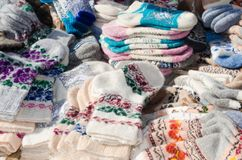 Variety woolen socks on christmas market. Royalty Free Stock Image