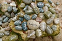 Variety of words painted on stones in a pile royalty free stock photo