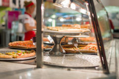 Variety of yummy pizzas under shopping window Royalty Free Stock Images