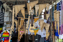 A variety of zamponas (pan flutes) and a guitar for sale at the market in Peguche in Ecuador. Stock Images