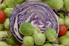 Vario col verde de la cabeza del litlle en la col violeta Imagen de archivo