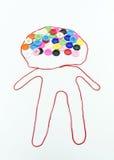 Variopinto dei bottoni che cucono con la forma del ragazzo su fondo bianco Immagine Stock Libera da Diritti