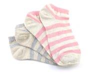 Variopinto dell'isolato dei calzini su fondo bianco Fotografie Stock