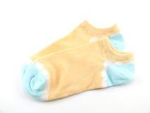 Variopinto dell'isolato dei calzini su fondo bianco Fotografia Stock Libera da Diritti