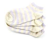 Variopinto dell'isolato dei calzini su fondo bianco Fotografia Stock