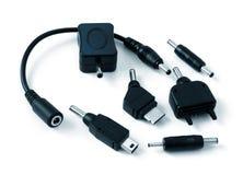 Varios adaptadores para los teléfonos celulares Imagen de archivo