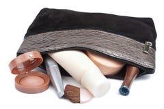 Varios cosméticos en el bolso aislado Imágenes de archivo libres de regalías