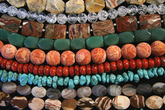 Varios granos coralinos Imagenes de archivo