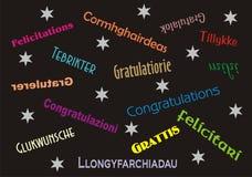 Varios idiomas de la bandera de la enhorabuena imagen de archivo