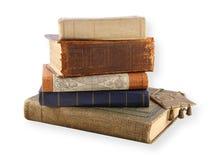 Varios libros viejos aislados en blanco Imagen de archivo libre de regalías