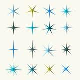 Varios tonos de los símbolos de las chispas en el fondo blanco Imagen de archivo