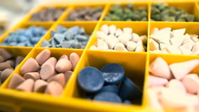 Various abrasive grinding stones at industry. Panning shot of various abrasive grinding stones in crate at industry stock video footage