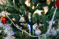 Various accessories such as bow bells, balls on the Christmas tree. The various accessories such as bow bells, balls on the Christmas tree stock photos