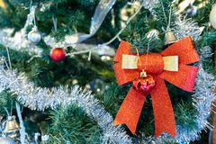 Various accessories such as bow bells, balls on the Christmas tree. The various accessories such as bow bells, balls on the Christmas tree stock photo