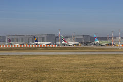 Various Airbus A380. HAMBURG, GERMANY - March 3rd, 2014: Airbus A380 Airplanes for Qatar, Lufthansa, Emirates and Korean Air in different development stages on Royalty Free Stock Image