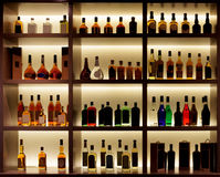 Various alcohol bottles in a bar, back light, logos removed Stock Photography
