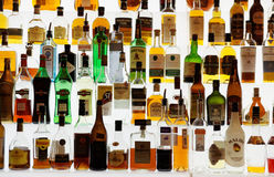 Various alcohol bottles in bar Stock Photo