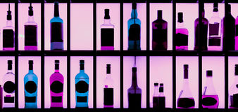 Various alcohol bottles in a bar, toned Royalty Free Stock Images