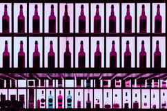 Various alcohol bottles in a barm toned image Stock Photography