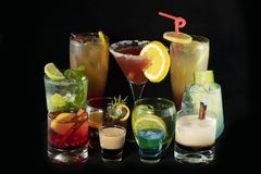 Mix alcoholic cocktails together with isolated black background royalty free stock photography