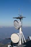Various antenna installed on a mountain top Stock Photos